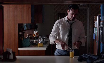 Don Draping Drinking Orange Juice